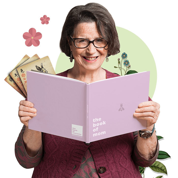 Recipient Holding A Personalized Book of Mom